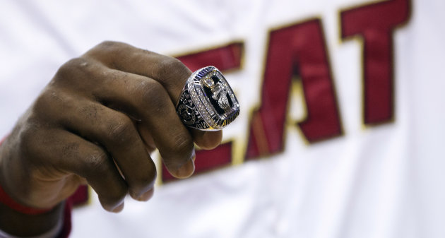 Miami Heat's LeBron James holds his 2012 NBA Finals championship ring during a ceremony before a basketball game against the Boston Celtics, Tuesday, Oct. 30, 2012, in Miami. (AP Photo/J Pat Carte