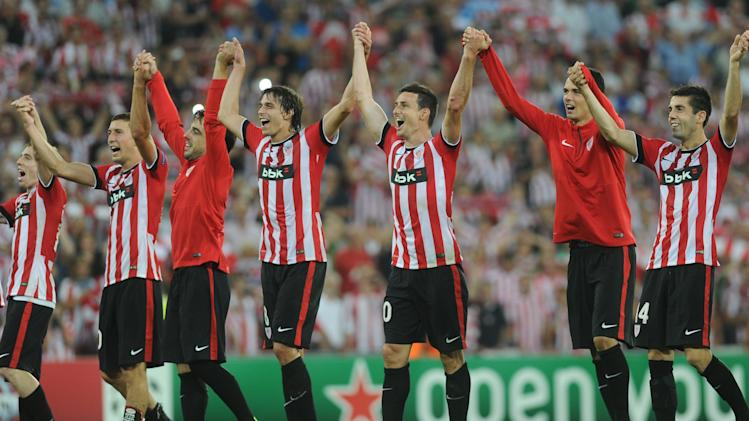 Athletic Bilbao's players celebrate after winning the UEFA Champions League play-off second leg football match Athletic Bilbao vs SSC Napoli in Bilbao on August 27, 2014