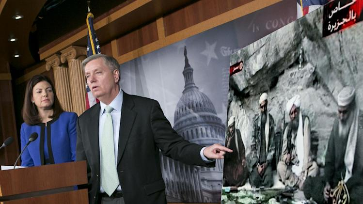 "Sen. Lindsey Graham, R-S.C., accompanied by Sen. Kelly Ayotte, R-N.H., speaks to reporters on Capitol Hill In Washington, Thursday, March 7, 2013, about the capture of Osama Bin Laden's son-in-law Sulaiman Abu Ghaith. Sulaiman Abu Ghaith , Osama bin Laden's spokesman and son-in-law has been captured by U.S. intelligence officials, officials said Thursday, in what a senior congressman called a ""very significant victory"" in the ongoing fight against al-Qaida. (AP Photo/J. Scott Applewhite)"