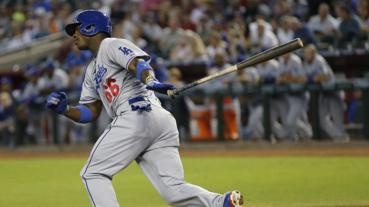 Los Angeles Dodgers' Yasiel Puig connects for a base hit during the first inning of a baseball game, Tuesday, July 9, 2013, in Phoenix. (AP Photo/Matt York)
