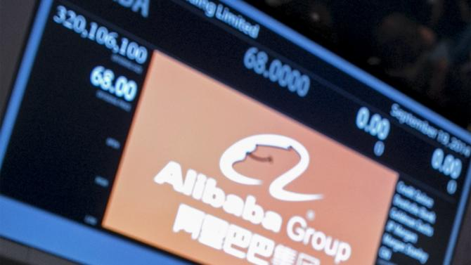 """Traders during the Alibaba Group Holding Ltd IPO under the ticker """"BABA"""" at the NYSE in New Yor"""