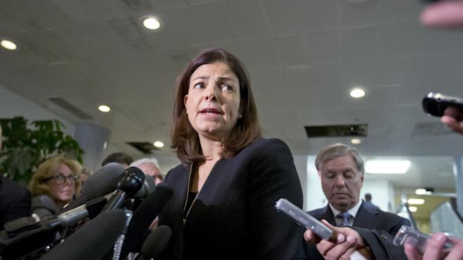 Senate Armed Services Committee member, Sen. Kelly Ayotte, R-N.H.,, center, accompanied by fellow Senate Armed Services Committee member, Sen. Lindsey Graham, R-S.C., right, speaks to reporters on Capitol Hill in Washington, Tuesday, Nov. 27, 2012, following a closed-door meeting with UN Ambassador Susan Rice.  (AP Photo/J. Scott Applewhite)