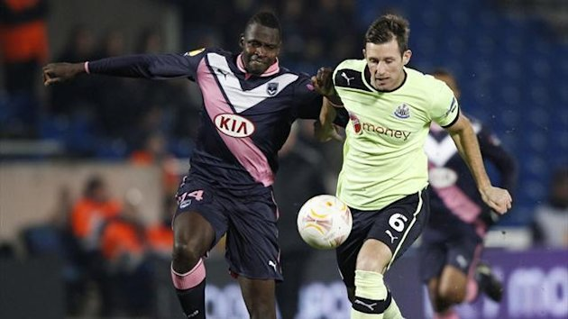 Bordeaux&#39;s Diabate fights for the ball with Newcastle United&#39;s Perch in the Europa League (Reuters)