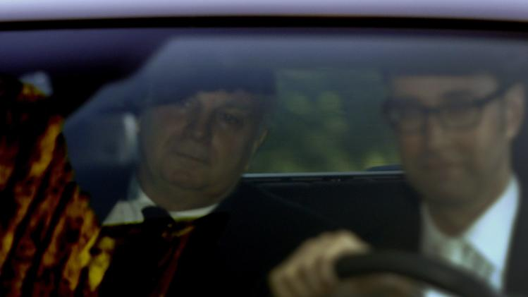 Bayern Munich President Hoeness arrives by car for his tax evasion trial at regional court in Munich