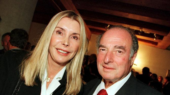 FILE - This is a Nov. 27, 2000. file photo of Marc Rich and his wife Gisela as they pose during an award ceremony at the city hall in Zug, central Switzerland. An associate of Marc Rich said Wednesday June 26, 2013, that the trader pardoned by President Clinton has died in Switzerland.(AP Photo/Urs Flueeler, File) NO SALES TV OUT