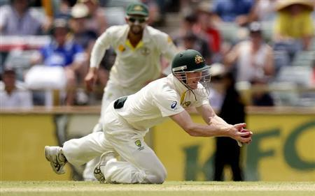 Australia's George Bailey takes the final catch to dismiss England's James Anderson and win the Ashes test cricket series at the WACA ground in Perth December 17, 2013. REUTERS/Philip Brown