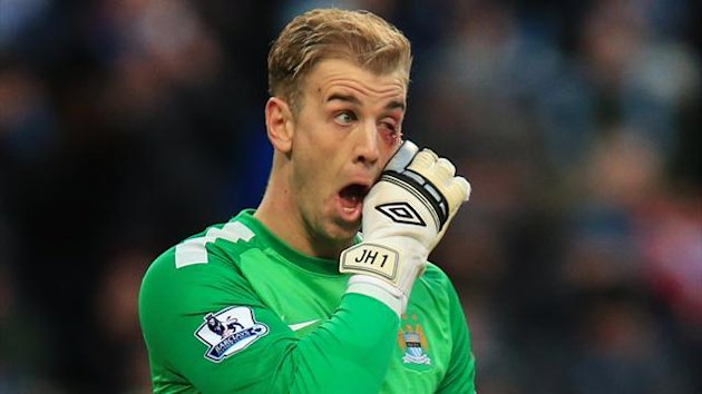 Manchester City's Joe Hart receives treatment for an eye injury in the match against Crystal Palace (PA Photos)