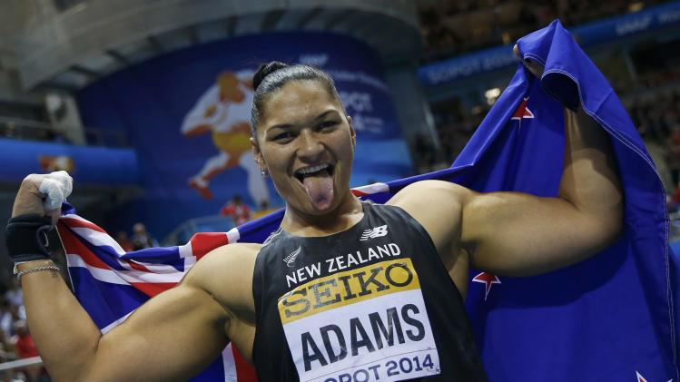 Adams of New Zealand celebrates her first place in the women's shot put final at the world indoor athletics championships at the ERGO Arena in Sopot