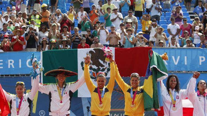 From left: silver medal winners Mayra Garcia and Bibiana Candelas, from Mexico, gold medal winners Juliana Silva and Larissa Franca, from Brazil, and bronze medal winners Yarleen Santiago and Yamileska Yantin, of Puerto Rico, celebrate at the podium during women's beach volleyball award ceremony at the Pan American Games in Puerto Vallarta, Mexico, Friday, Oct. 21, 2011. (AP Photo/Ariana Cubillos)