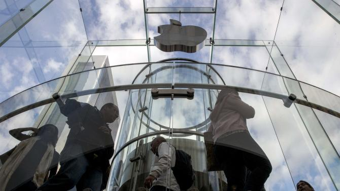 Customers enter the Fifth Avenue Apple store in Manhattan, New York