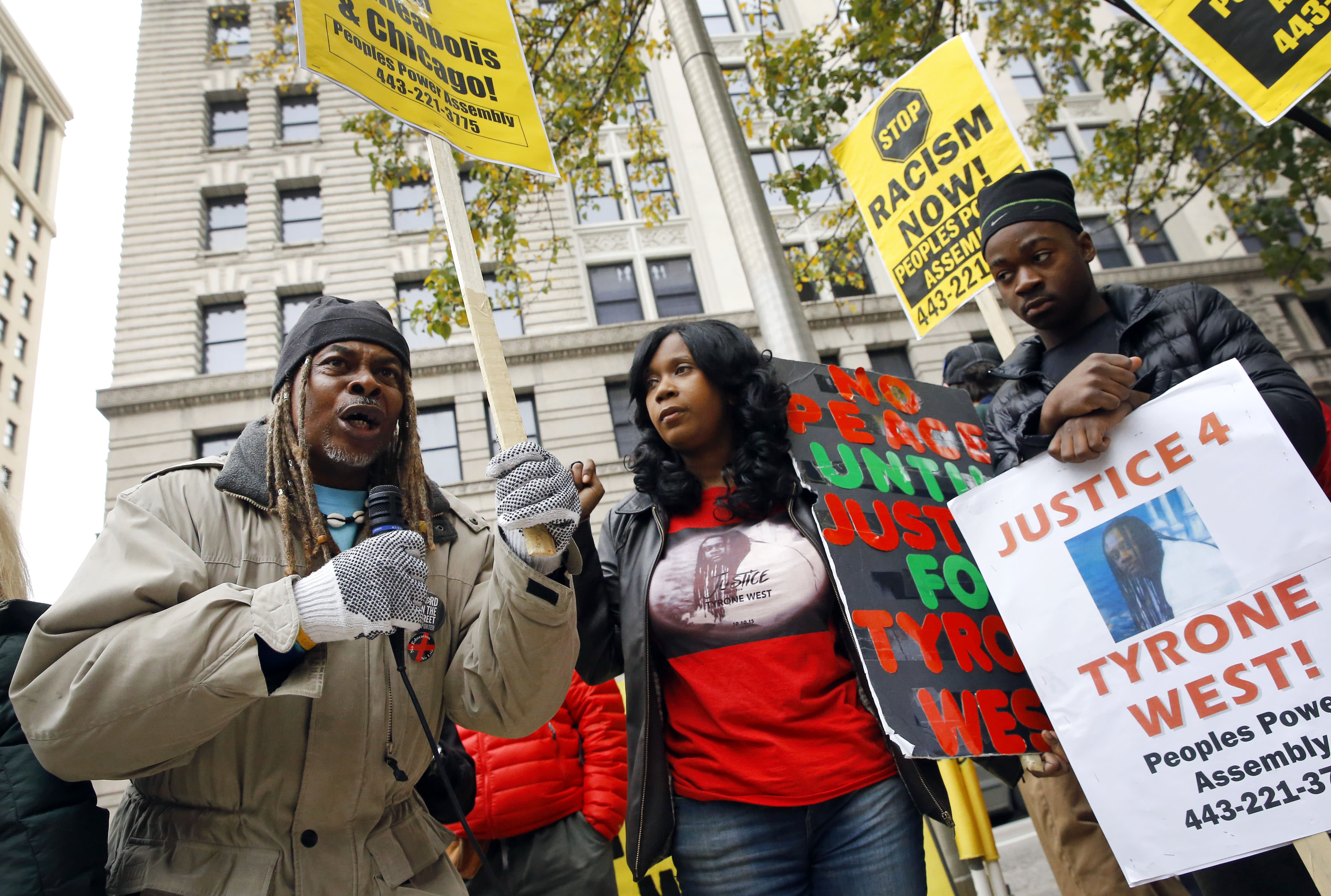 The Latest: Demonstrators rally for justice for Freddie Gray