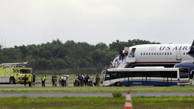 A plane from Ireland makes an emergency landing because of an unspecified threat, Wednesday, Aug. 7, 2013, in Philadelphia. (AP Photo/Matt Rourke)