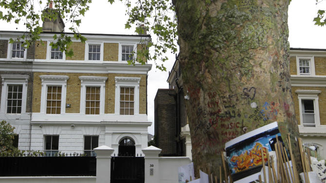The house owned by the late British singer Amy Winehouse is seen in north London, Thursday, May 31, 2012. The family of Amy Winehouse has put the late singer's London home up for sale for 2.7 million pounds ($4.2 million).The three-bedroom property in the Camden neighborhood of northwest London had become a shrine of sorts for mourning fans who left flowers and tributes following Winehouse's death last July from alcohol poisoning. A spokesman for the Winehouse family, said Thursday May 31, 2012 that the singer had loved the house and her family put it on the market because they felt it would be inappropriate for any of them to live there..  (AP Photo/Sang Tan)