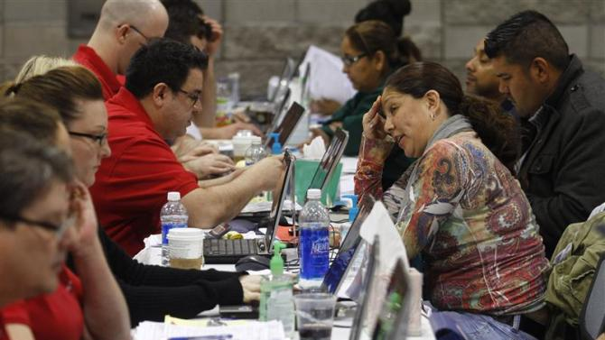 Home owners speak with Bank of America representatives as they try to get home loan modifications during the Neighborhood Assistance Corporation of America event in Phoenix