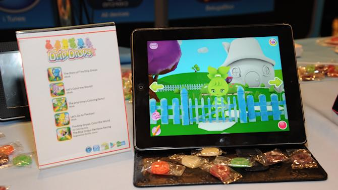 IMAGE DISTRIBUTED FOR DRIP DROPS - Atmosphere seen at CES Showstoppers, on Tuesday, Jan. 8, 2013, in Las Vegas, Nevada, Drip Drops debuts Color the World app turning a tablet into a 3d digital coloring book for preschoolers. (Photo by Al Powers/Invision for Drip Drops/AP Images)