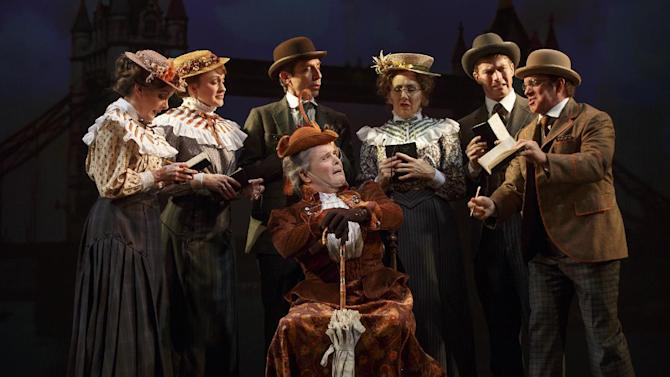 "This theater image released by The O+M Company shows Jefferson Mays , seated center, with the cast during a performance of ""A Gentleman's Guide to Love and Murder,"" at the Walter Kerr Theatre in New York. (AP Photo/The O+M Company, Joan Marcus)"