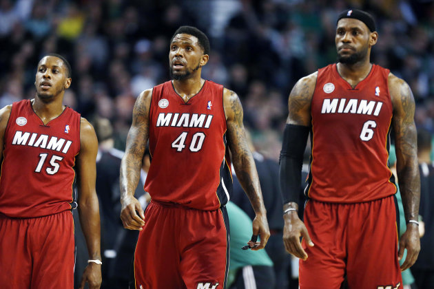 Miami Heat's Mario Chalmers (15), Udonis Haslem (40) and LeBron James (6) walk upcourt after a timeout in the first quarter of an NBA basketball game against the Boston Celtics in Boston, Monday, Marc