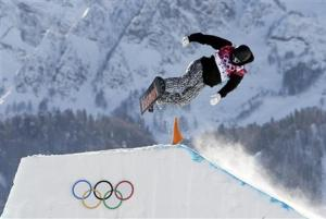 Finland's Janne Korpi performs a jump during the men's slopestyle snowboarding qualifying session at the 2014 Sochi Olympic Games in Rosa Khutor