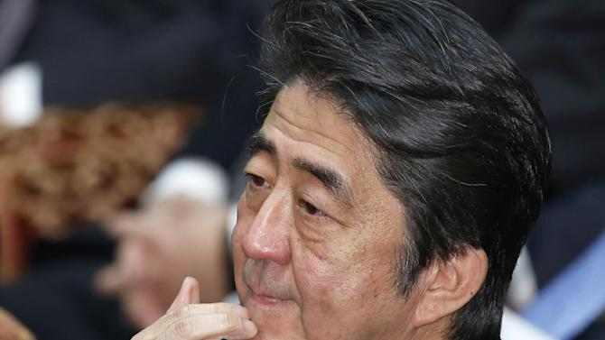 Japan's Prime Minister Shinzo Abe ponders during a lower house budget committee session at Parliament in Tokyo Thursday, Jan. 29, 2015. Japan was studying the latest message purportedly from the Islamic State group, which extends the deadline for Jordan's release of an Iraqi prisoner, while officials worked feverishly Thursday to try to free a Japanese journalist held by the militant group. (AP Photo/Shizuo Kambayashi)