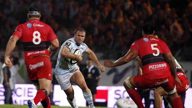 Racing-Metro's centre Jamie Roberts runs with the ball during the French Top 14 rugby union match between Racing Metro 92 and RC Toulon on August 30, 2014, at the Yves du manoir Stadium in Colombes