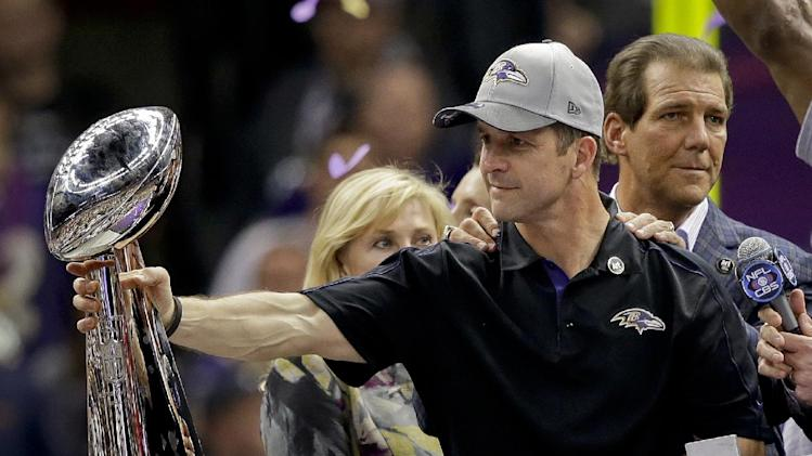Baltimore Ravens head coach John Harbaugh holds out the Vince Lombardi Trophy as owner Stephen J. Bisciotti, right, stands by after defeating the San Francisco 49ers 34-31 in the NFL Super Bowl XLVII football game, Sunday, Feb. 3, 2013, in New Orleans. (AP Photo/Marcio Sanchez)