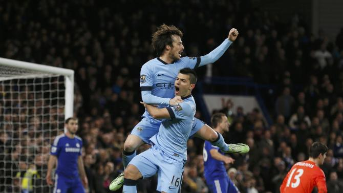 Manchester City's David Silva celebrates his goal with teammate Sergio Aguero during their English Premier League soccer match at Stamford Bridge in London