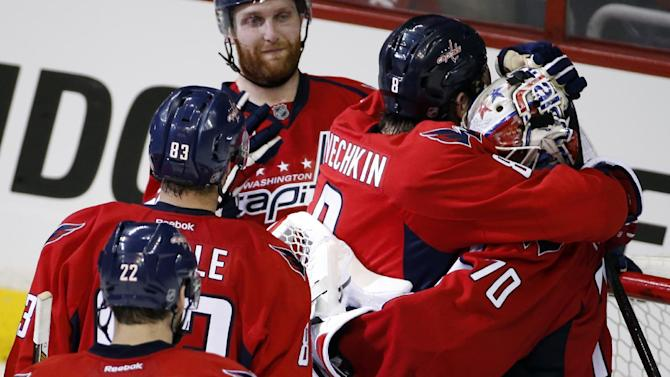 Washington Capitals left wing Alex Ovechkin (8), from Russia, embraces goalie Braden Holtby (70) after  Game 3 in the second round of the NHL Stanley Cup hockey playoffs against the New York Rangers, Monday, May 4, 2015, in Washington. The Capitals won 1-0. (AP Photo/Alex Brandon)