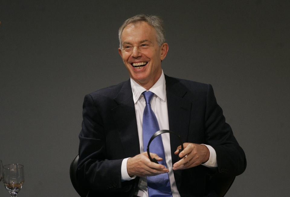 Former British Prime Minister Tony Blair laughs during a lecture with students about education at a university in Sao Paulo, Brazil, Tuesday, Oct. 26, 2010. (AP Photo/Nelson Antoine)