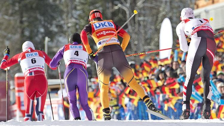Athletes ski in the stadium during the individual Gundersen competition at the Nordic Combined FIS World Cup in Oberstdorf, southern Germany, Sunday, Jan. 26, 2014