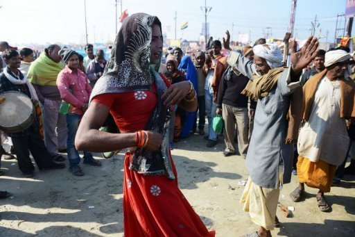 An Indian man dances after taking a dip in the River Ganges during the Kumbh Mela in Allahabad on February 9, 2013
