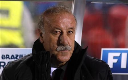 Spain's coach Vicente del Bosque sits in the bench before their 2014 World Cup qualifying soccer match against Belarus at Son Moix stadium in Palma de Mallorca October 11, 2013. REUTERS/Gustau Nacarin