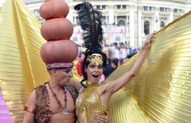 Guests in fancy costumes arrive for the opening ceremony of the 21st Life Ball in front of city hall in Vienna, Austria, on Saturday, May 25, 2013. The Life Ball is a charity gala to raise money for p