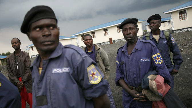Congolese  policemen gather at the  Mugunga police training center near the eastern Congolese town of Goma, Friday Nov. 23 2012.  The officers were called by M23 rebel officials to receive an ideological briefing.  Platoons of rebels were making their way across the hills from Sake to the next major town of Minova, where the Congolese army was believed to be regrouping. The militants seeking to overthrow the government vowed to push forward despite mounting international pressure.(AP Photo/Jerome Delay)