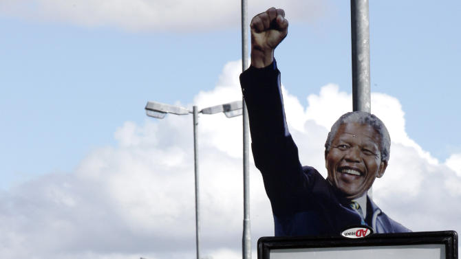 A poster with a picture of former South African President Nelson Mandela in Bloemfontein, South Africa, Saturday, Dec. 15, 2012, ahead of the ruling party elective conference where the current President Jacob Zuma will fight for a second term as head of the ruling party. Mandela on Friday, Dec 14 2012 entered the seventh day of a hospital stay for a lung infection as questions grow about where he is receiving treatment. The 94-year-old patriarch of South Africa's democracy has been hospitalized since Saturday, first undergoing tests and later being diagnosed with the ailment.  (AP Photo/Themba Hadebe)
