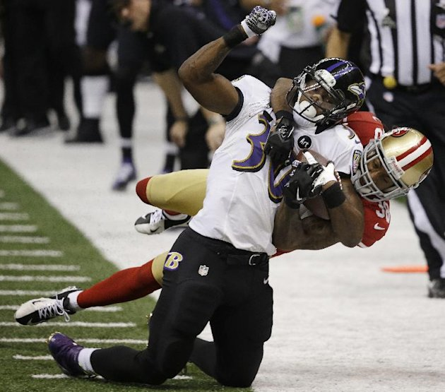 FILE - In this Feb. 3, 2013 file photo, San Francisco 49ers safety Dashon Goldson (38) tackles Baltimore Ravens running back Bernard Pierce (30) during the second half of the NFL Super Bowl XLVII foot