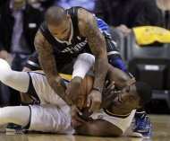 Orlando Magic guard Jameer Nelson, top, tries to tie up Indiana Pacers center Roy Hibbert as the go for a loose ball in the first half of an NBA first-round playoff basketball game in Indianapolis, Saturday, April 28, 2012. (AP Photo/Michael Conroy)
