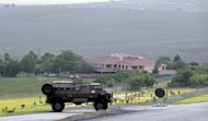 A South African military vehicle is parked near the residence of the late Nelson Mandela in Qunu, outside Mthatha, on December 6, 2013