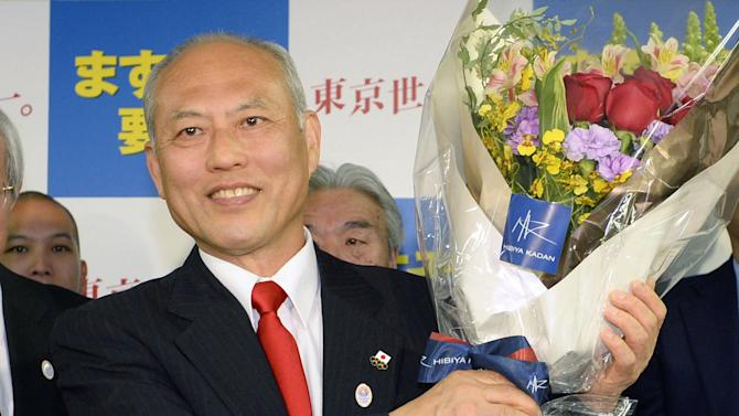 Former Health Minister Yoichi Masuzoe celebrates his gubernatorial election victory at his election office in Tokyo, Sunday, Feb. 9, 2014. Masuzoe, backed by Japan's ruling party, won Tokyo's gubernatorial election on Sunday, defeating two candidates who had promised to end nuclear power. (AP Photo/Kyodo News) JAPAN OUT, MANDATORY CREDIT