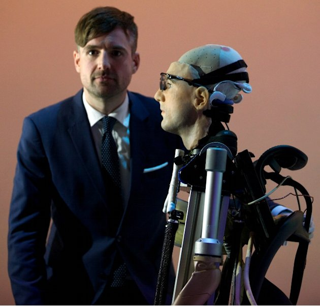 Researcher Bertolt Meyer, a lifelong user of prosthetic technology and the model for &quot;Rex&quot;, the world's first &quot;bionic man&quot;, poses with the humanoid during a photo call at the Science Museum in London 