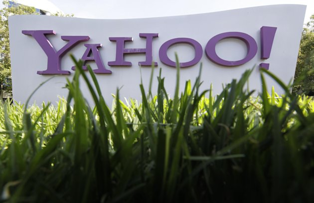 FILE - In this May 20, 2012 file photo, a Yahoo sign stands outside the company&#39;s offices in Santa Clara, Calif. Yahoo turned in another lackluster performance in the second quarter announce the company on Tuesday, July 17, 2012. The results underscore the challenges facing Yahoo&#39;s newly hired CEO Marissa Mayer as she tries to turn around the Internet company after a 13-year career as a top Google executive. (AP Photo/Paul Sakuma, File)