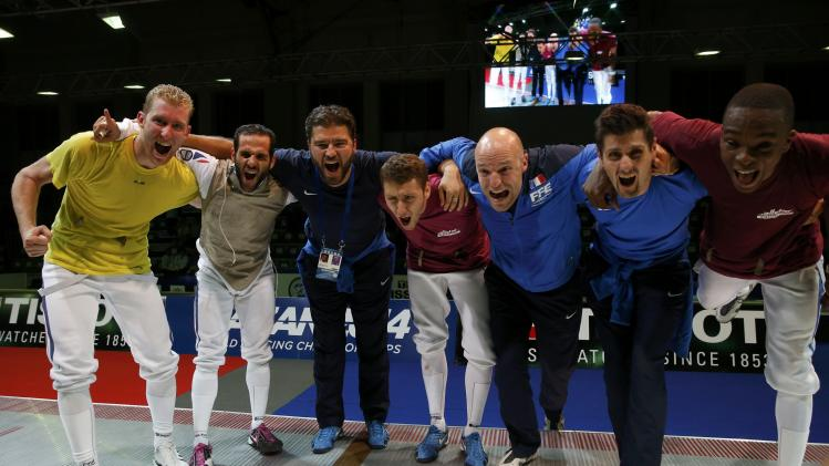 Team France celebrate victory over China in the final of the men's team foil at the World Fencing Championships in Kazan