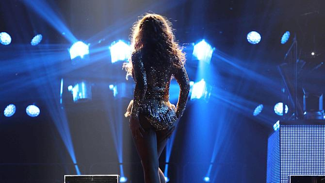 "Singer Beyonce performs on the opening night of her ""Mrs. Carter Show World Tour 2013"", on Monday, April 15, 2013 at the Kombank Arena in Belgrade, Serbia. Beyonce is wearing a custom gold, flesh-toned one-piece by designers The Blonds.(Photo by Yosra El-Essawy/Invision for Parkwood Entertainment/AP Images)"