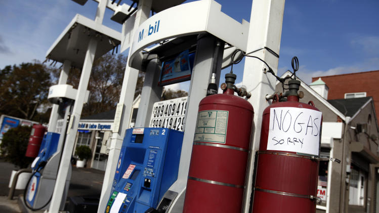 Apologetic signs are posted at a gas station that has run out of gas on Queens Boulevard, Thursday, Nov. 1, 2012, in the Queens borough of New York.  The price of oil is rising as operations at refineries and supply terminals in the Northeast remain restricted three days after Superstorm Sandy. Benchmark oil gained 60 cents Thursday to $86.84 per barrel in New York.  (AP Photo/Jason DeCrow)