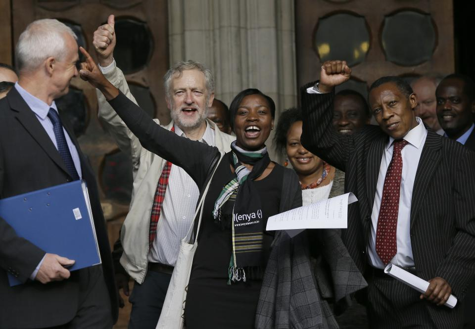 Supporters cheer outside the Royal Courts of Justice in London following a verdict in the Mau Mau torture compensation claim case, Friday, Oct. 5, 2012. TBritain's High Court has ruled that three Kenyans tortured during the Mau Mau rebellion against British colonial rule can proceed with compensation claims against the British government. (AP Photo/Kirsty Wigglesworth)