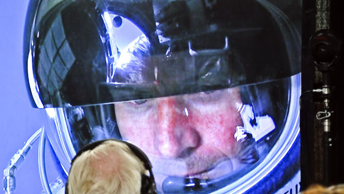 In this photo provided by Red Bull, pilot Felix Baumgartner of Austria is seen in a screen at mission control center in the capsule during the final manned flight for Red Bull Stratos in Roswell, N.M. on Sunday, Oct. 14, 2012.   Baumgartner plans to jump from an altitude of 120,000 feet, an altitude chosen to enable him to achieve Mach 1 in free fall, which would deliver scientific data to the aerospace community about human survival from high altitudes.(AP Photo/Red Bull Stratos, Stefan Aufschnaiter) MANDATORY CREDIT