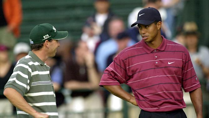 "FILE - In this June 16, 2002 file photo, Sergio Garcia, left, and Tiger Woods talk on the 11th hole while waiting for play to resume after a rain delay during the final round of the U.S. Open Golf Championship in Farmingdale, N.Y.  Garcia was at a European Tour awards dinner Tuesday night, May 21, 2013 when he was jokingly asked if he would have Woods over for dinner during the U.S. Open. The Spaniard replied, ""We'll have him round every night. We will serve fried chicken."" Woods took to Twitter on Wednesday, May 22, 2013 and said the comment wasn't silly, rather it was wrong and hurtful. (AP Photo/Dave Martin, File)"