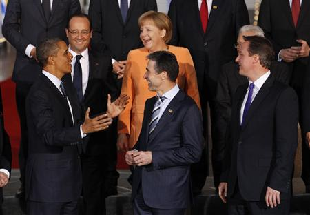 U.S. President Barack Obama talks to other leaders before posing for a family photo at the NATO Summit in Chicago