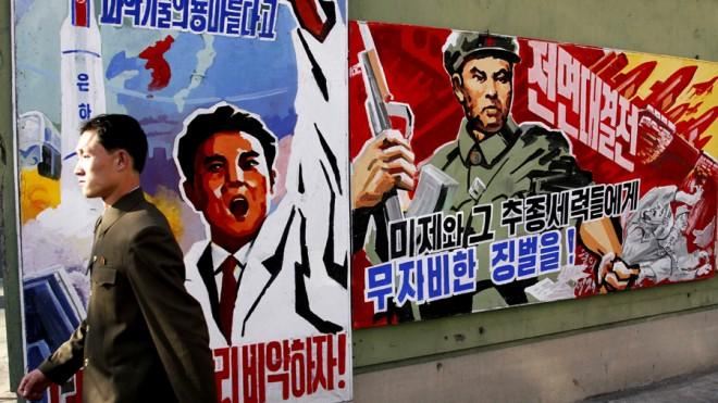 A man walks past propaganda posters in Pyongyang, North Korea on March 26.