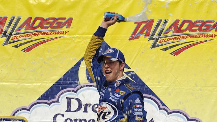 Brad Keselowski (2) celebrates in victory lane after winning the NASCAR Sprint Cup Series auto race at Talladega Superspeedway in Talladega, Ala., Sunday, May 6, 2012.  (AP Photo/Rainier Ehrhardt)