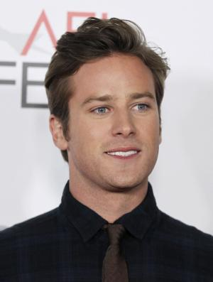 """FILE - In this Nov. 4, 2011 file photo, actor Armie Hammer poses for photographers after the Young Hollywood Panel during AFI FEST 2011 in Los Angeles. The town of Sierra Blanca, Texas, which is losing more and more residents every year, is attracting nationwide attention as a magnet for pot-toting celebrities who have been arrested for possession at a Border Patrol checkpoint outside town. Hammer was arrested Nov. 20, 2011, at a border patrol checkpoint in West Texas after a drug sniffing dog discovered marijuana in his car. The 25-year-old, who starred with Leonardo DiCaprio in """"J. Edgar,"""" spent about a day in jail before paying a $1,000 bond. (AP Photo/Matt Sayles, file)"""